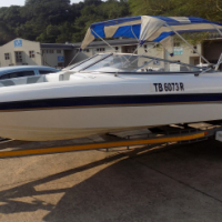 classic 210 on trailer 200 hp mercury trim & tilt low hours