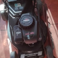 petrol lawn mover (needs attention)