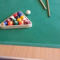 Pool table with 2x cue sticks and Pool balls