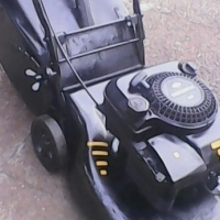 Briggs Stratton 4HP petrol lawnmower in excellent condition