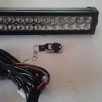 Spotlight bar brand new with harness and remote for sale