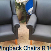 Smaller leather wingback chairs