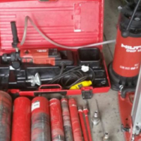 Hilti coring machine DD 130 with stand and water canister with extra bits