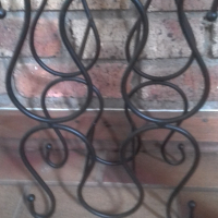 Solid iron wine stand