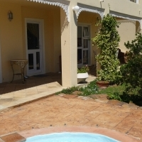 Beautiful new fully furnished flat in upmarket security estate with private garden and pool