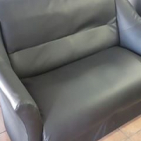 Immaculate Black PU Leather 2 seater Couch