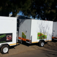 MOBILE KITCHENS / TRAILERS UNLIMITED.