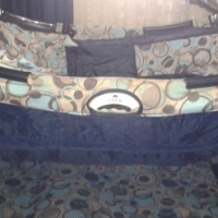 Camping cot with changing station and mattress