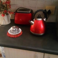 Red Russell hobb kettle and toaster combo set.