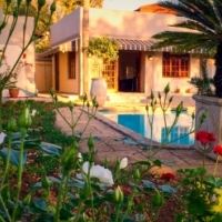 Brand new and furnished self-catering suites in well established private gardens with pool.