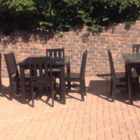 Four seater black restaurant tables