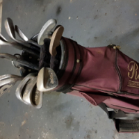 1 Eezee golf set and 1tommy armour golf set