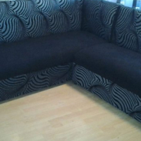 L shape couch black and grey in colour
