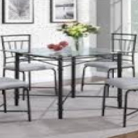 Glass top with 4 padded chairs like new
