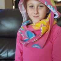 A very Chic - Hooded scarf. Great for cold windy days.