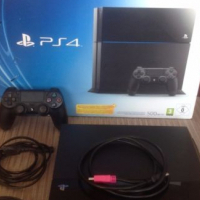 PS4 500GB with 2 Remotes + 8 Games HOTTT