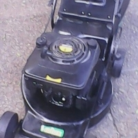 Rolux 4 HP petrol lawnmower in excellent condition