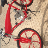 Motorized bicycles and engine kits