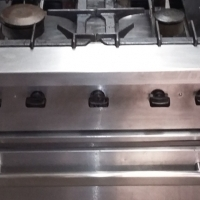 Reconditioned commercial gas stove with gas oven