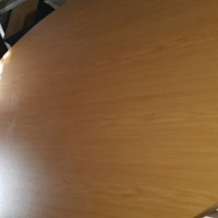 Oval wooden boardroom table