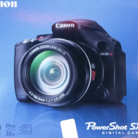 Canon SX 30 IS digital camera with memory card