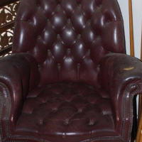 Leather button chair in good condition, has a tear on the left armrest. R2500