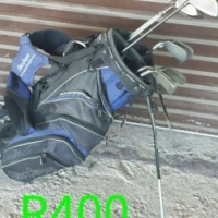 Golf clubs and bag with stand.