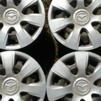 "Mazda Rims and Hubcaps 4x14"" inch neg."