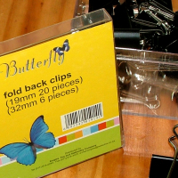 Brand new Butterfly fold back clips
