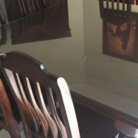 Eight seater dining room table and chairs