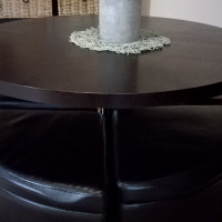 Round dining set with 4 storage seats on wheels