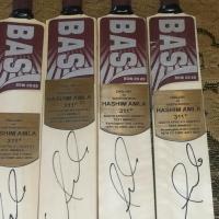 HASHIM AMLA signed mini bat 311