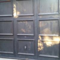 2 wooden single doors including motors