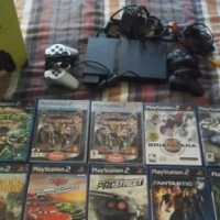 Playstation 2 with games and controls