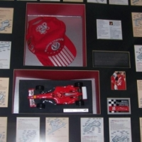 Signed and framed Ferrari 7 Times World Champions