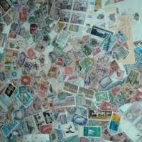 Very old stamps and a old newspaper