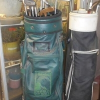 Two golf bags, with all the clubs