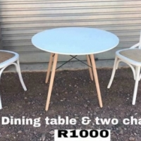 Round dining table and two chairs for sale.