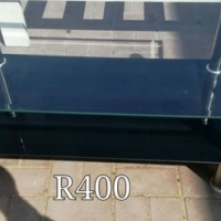 Glass and steel table for sale.