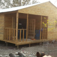 Knotty pine wooden home with a 2x10 side veranda