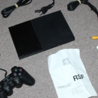 PS2 slim console with original dual shock 2 remote controller