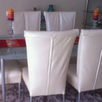 Chrome, glass and leather dining set.