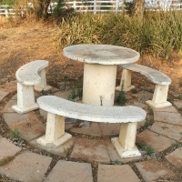 3 concrete benches and a table