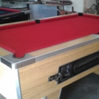 Coin operated pool table for sale.
