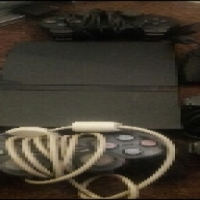 Playstation 2 with 5 remotes and 2 games