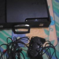 PlayStation 3 with remote and game