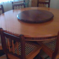 American yellow wood/mbuija dinning table +8 chairs(Riempies chairs) + the Buffet cupboard