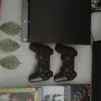 Playstation 3 with games and 2 controlls