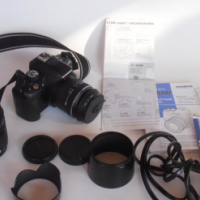 Olympus E-600 DSLR camera with two lenses