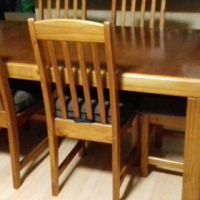 6 Seater pine dining room table and chairs for sale.